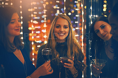 Buy stock photo Portrait of a group of happy friends enjoying drinks in a nightclub