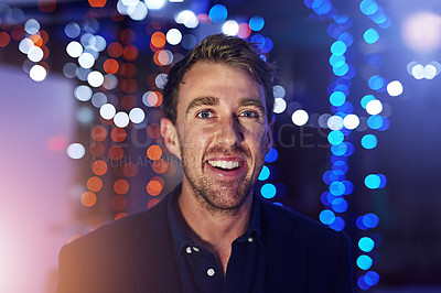 Buy stock photo Portrait of a happy young man posing alone on the balcony of a nightclub