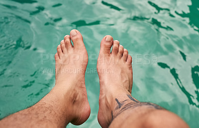 Buy stock photo High angle shot of a man's feet above the water