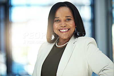 Buy stock photo Portrait of a confident businesswoman standing in an office