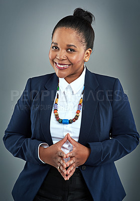 Buy stock photo Studio portrait of a confident businesswoman posing against a gray background