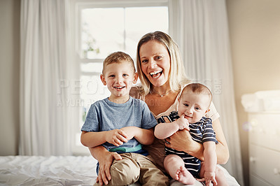 Buy stock photo Full length portrait of a mother sitting on a bed at home with her sons