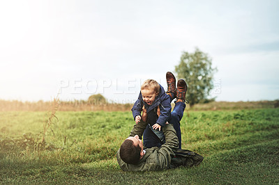 Buy stock photo Shot of a father bonding with his son outside