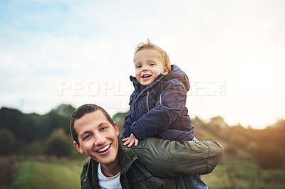 Buy stock photo Portrait of a father bonding with his son outside