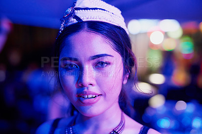 Buy stock photo Portrait of a young woman working in a neon lit Thai nightclub