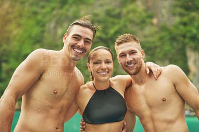 Buy stock photo Cropped portrait of three young friends enjoying a swim on a summer's day