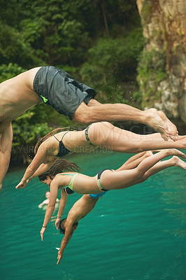 Buy stock photo Cropped shot of a group of young friends jumping into the ocean