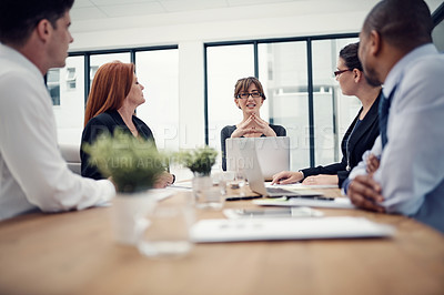 Buy stock photo Cropped shot of a group of businesspeople having a meeting in an office