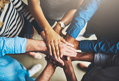Buy stock photo Shot of a group of creative businesspeople standing with their hands in a huddle