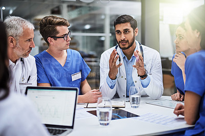 Buy stock photo Shot of a team of doctors having a meeting