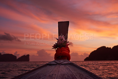 Buy stock photo Shot of the stern of a boat at sunset