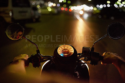 Buy stock photo POV shot of a man riding a motorbike at night