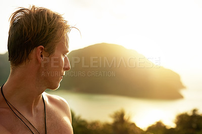 Buy stock photo Shot of a young man admiring a tropical view while on holiday