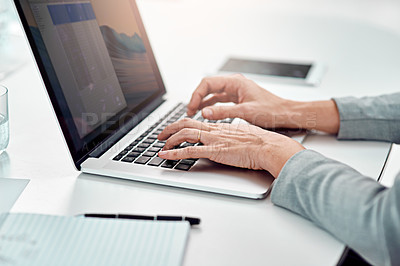 Buy stock photo Shot of an unrecognizable businesswoman working on her laptop in the office