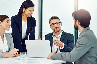 Buy stock photo Cropped shot of a group of businesspeople meeting in their office