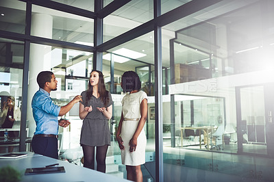 Buy stock photo Cropped shot of businesspeople having a discussion in an office