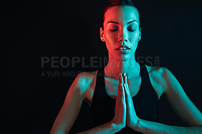 Buy stock photo Shot of a young woman working out