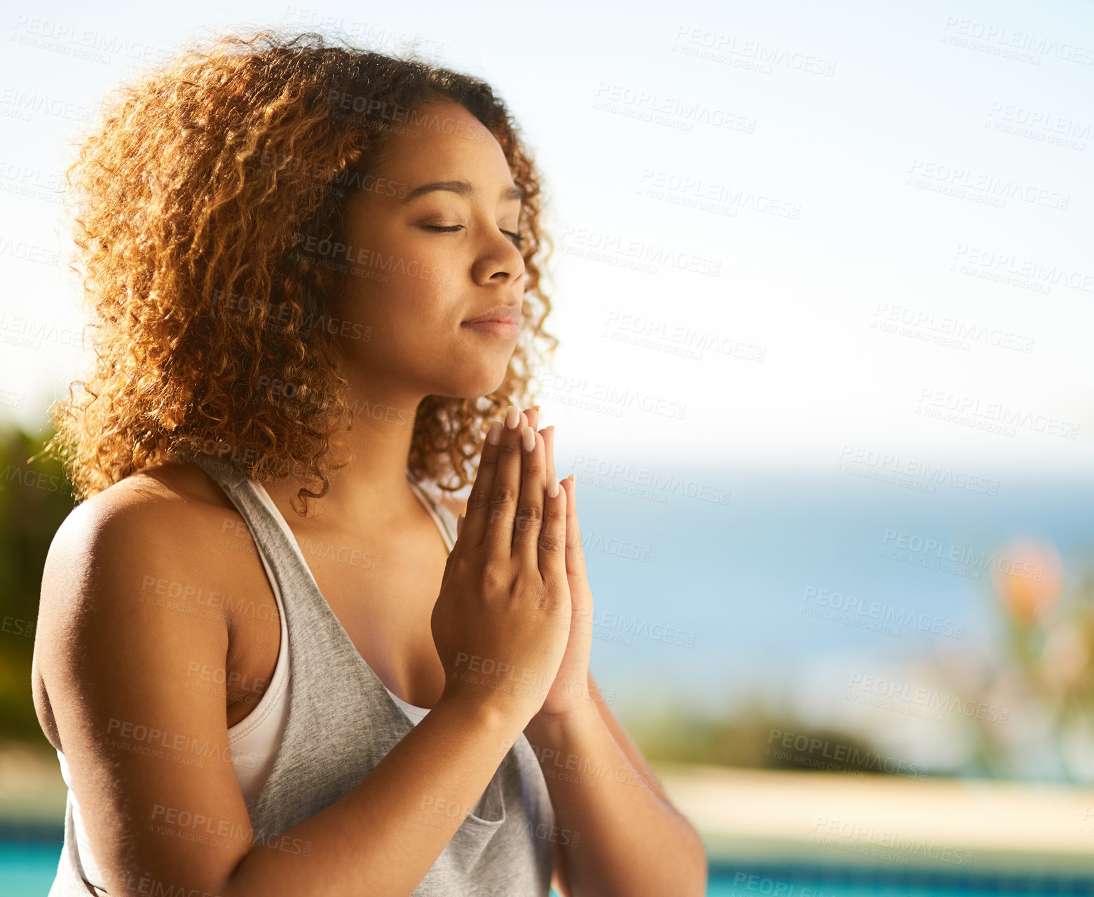 Buy stock photo Cropped shot of an attractive young woman meditating outdoors