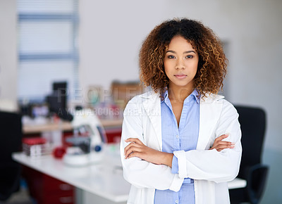 Buy stock photo Portrait of an attractive young scientist standing with her arms folded in the lab