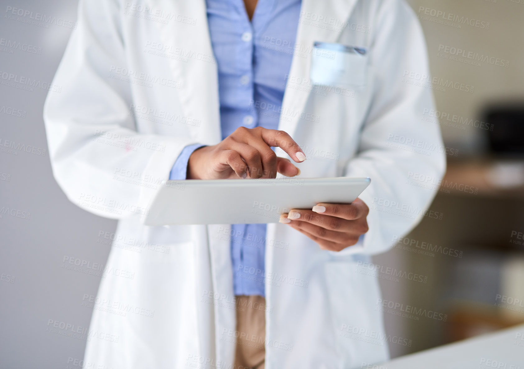 Buy stock photo Cropped shot of an unrecognizable young woman capturing data on her tablet in the lab