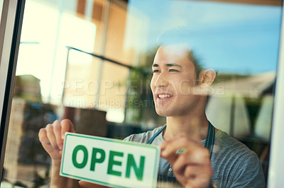 Buy stock photo Cropped shot of a young man hanging the