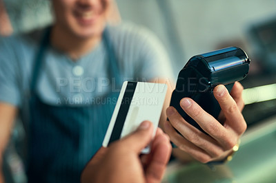 Buy stock photo Cropped shot of an unrecognizable barista taking a credit card payment