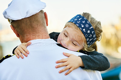 Buy stock photo Rearview shot of a father in a navy uniform hugging his happy little girl