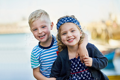 Buy stock photo Portrait of a cute little brother and sister posing together on a day out