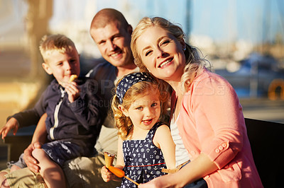Buy stock photo Portrait of a family with young children posing together by the harbor