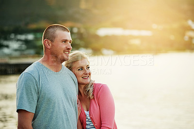 Buy stock photo Shot of an affectionate couple bonding at the beach