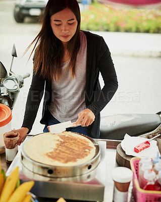 Buy stock photo Shot of a food vendor in Thailand preparing a tasty snack