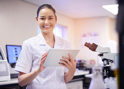 Buy stock photo Portrait of a young scientist using a digital tablet while working in a laboratory