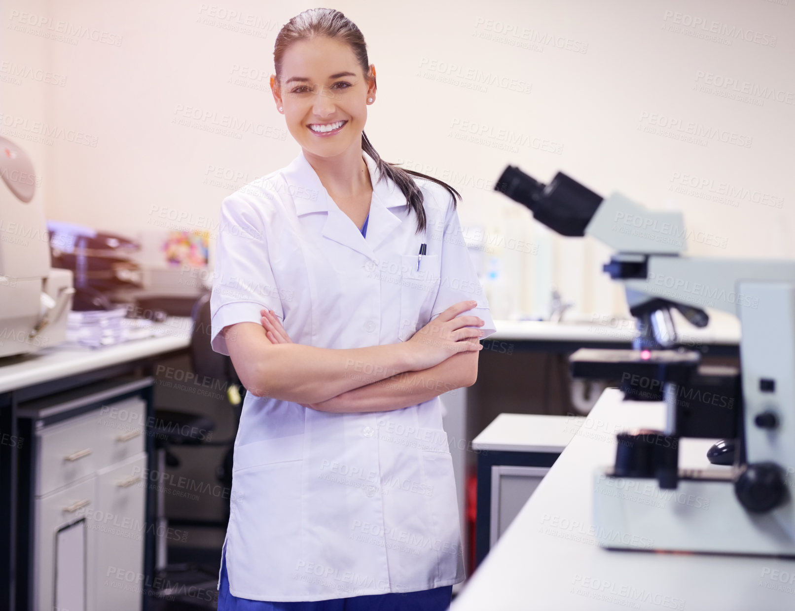 Buy stock photo Portrait of a confident young scientist working in a laboratory
