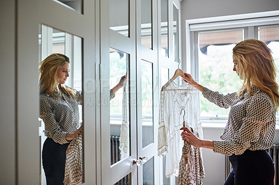 Buy stock photo Shot of a woman getting dressed in a long walk in closet full of mirrors
