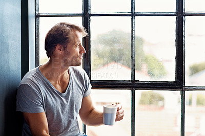 Buy stock photo Shot of a mature man sitting on a window sill at home drinking a cup of coffee