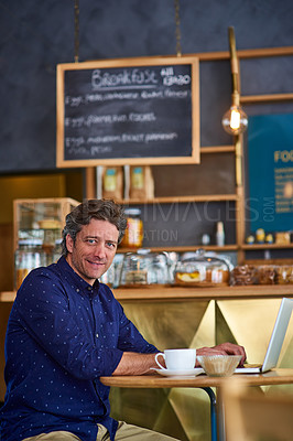 Buy stock photo Portrait of a smiling man working on a laptop in a cafe