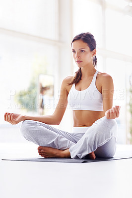 Buy stock photo Portrait of healthy young woman practicing yoga on exercising mat