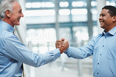 Buy stock photo Successful teamwork - Portrait of diverse business executives  shaking hands
