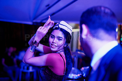 Buy stock photo Shot of a seedy businessman watching a woman dancing in a Thai nightclub
