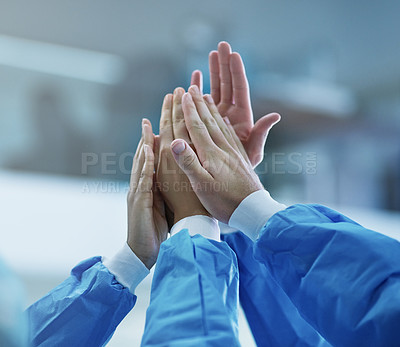 Buy stock photo Cropped shot of a team of surgeons giving each other a high five