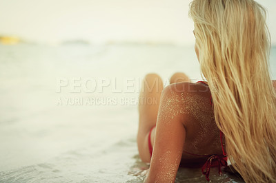 Buy stock photo Rearview shot of a young woman at the beach