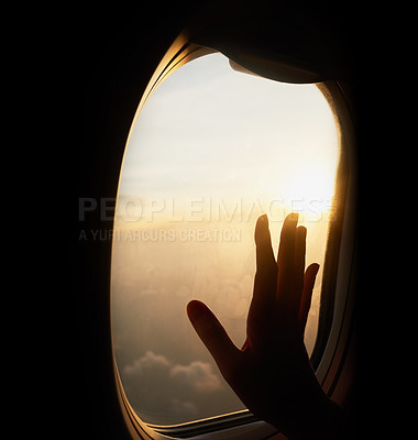 Buy stock photo Shot of an unrecognizable person's hand up against the window of a plane