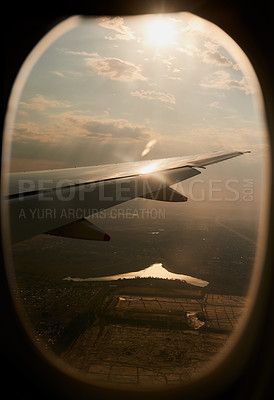 Buy stock photo Shot of the view through an airplane window
