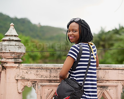 Buy stock photo Portrait of a happy young woman admiring the view while on vacation