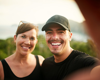 Buy stock photo Portrait of a happy young couple taking a selfie on an island vacation