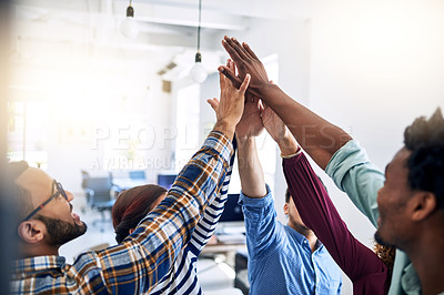 Buy stock photo Cropped shot of a team of designers high fiving together  in an office