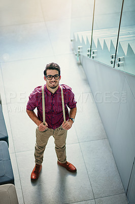 Buy stock photo High angle portrait of a handsome young designer standing in the office