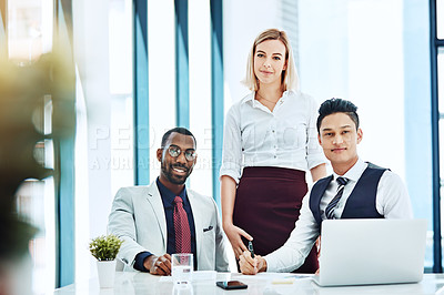 Buy stock photo Cropped portrait of three businesspeople working together in the office