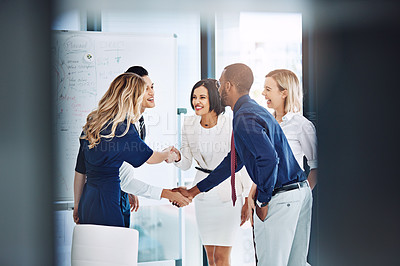 Buy stock photo Cropped shot of two business teams meeting and shaking hands in the office