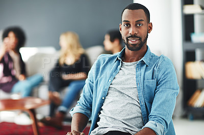 Buy stock photo Portrait of an ambitious young man in a modern office with his colleagues in the background